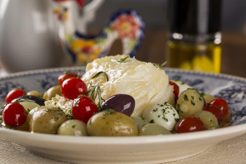 En typisk portugisisk maträtt med codfish kallade Bacalhau gör Porto arkivfoton