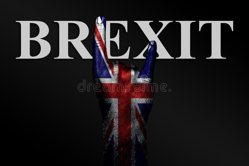 En un fondo oscuro, una mano con una bandera BRITÁNICA pintada y la palabra BREXIT muestra una muestra de la cabra, un símbolo de foto de archivo