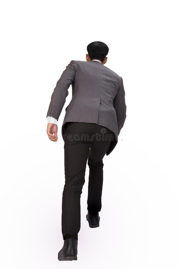 En ung affärsman på den startande linjen och ordnar till för att konkurrera arkivbild