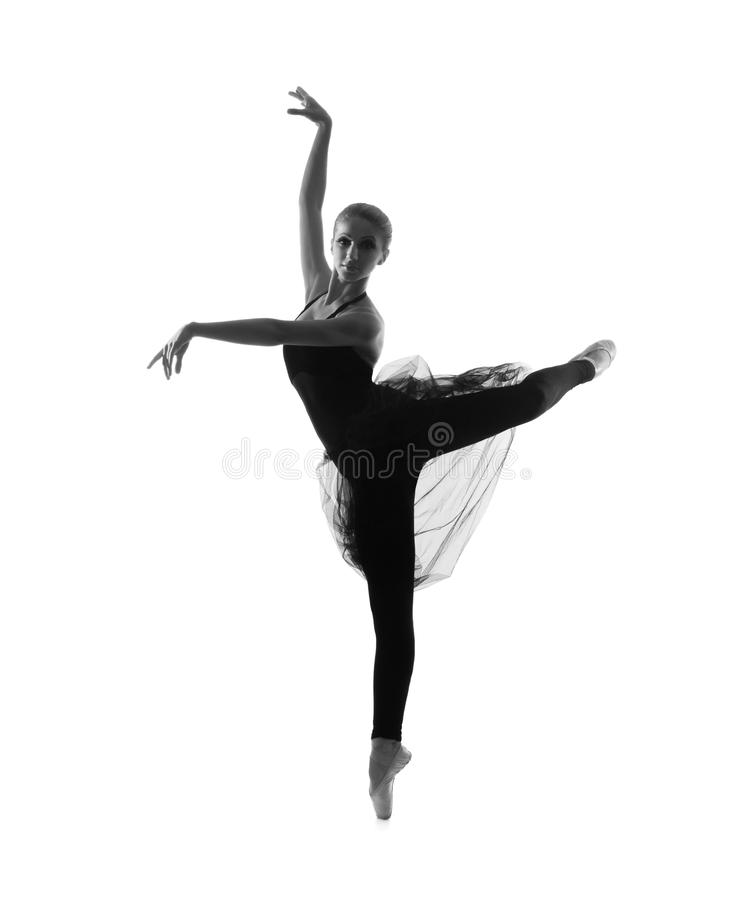 En ung Caucasian balettdansör i en svart klänning royaltyfria foton