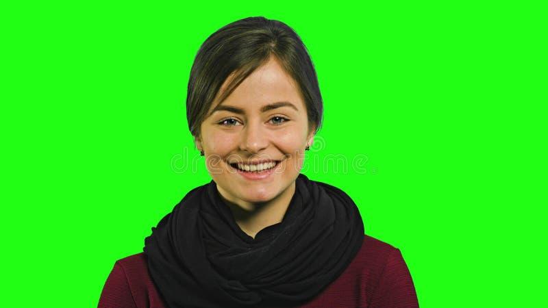 En ung dam Smiling royaltyfria bilder