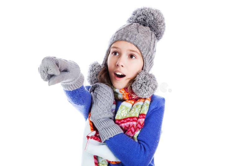 En ung flicka visar hennes finger royaltyfria foton