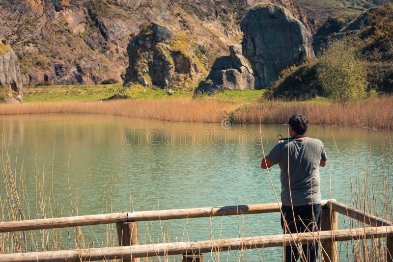 En ung man bara p? en sj?, st?ende, laarboleda, basque land fotografering för bildbyråer