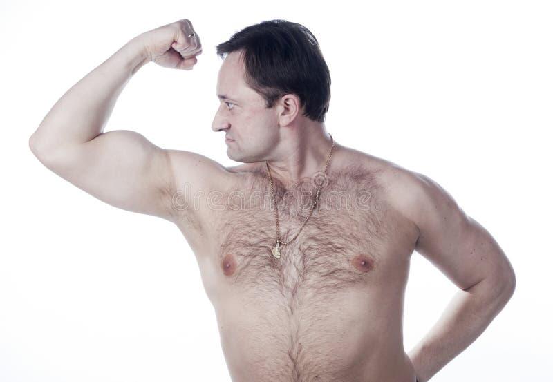 En ung man med ett bare-chested royaltyfri foto