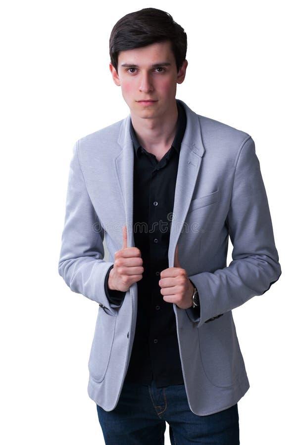 En ung manlig modellerar fotograferas i studion royaltyfri foto