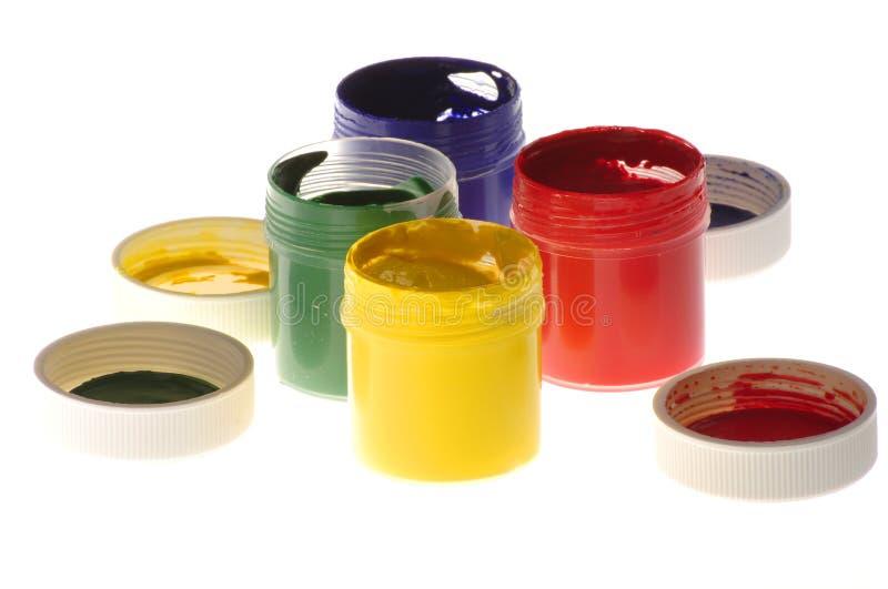En uppsättning av kulört färgpulver arkivfoton