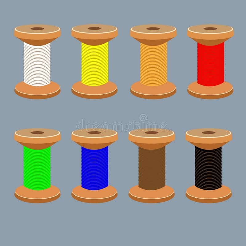 En uppsättning av spolar med mång--färgade trådar fotografering för bildbyråer
