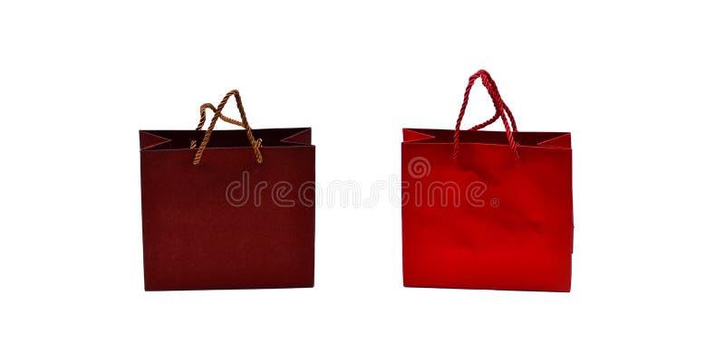 En uppsättning presentväskor som är isolerade på vit bakgrund, röd och brun arkivbilder