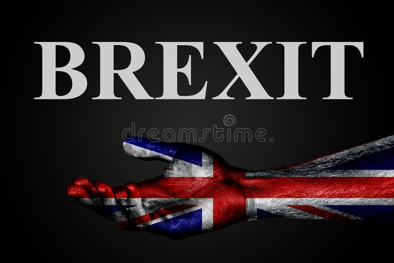 En utsträckt hand med en målad UK-flagga och ordet BREXIT, hjälptecken eller förfrågan, service eller armod på en mörk bakgrund fotografering för bildbyråer