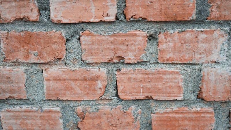 En vägg som göras från den röda tegelstenen fotografering för bildbyråer