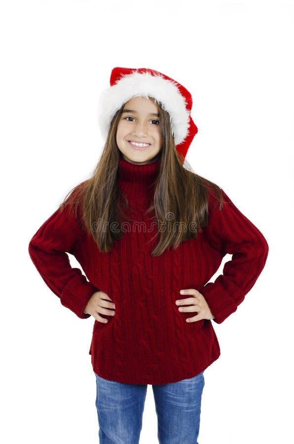 En vacker liten flicka i rött julhat royaltyfri bild