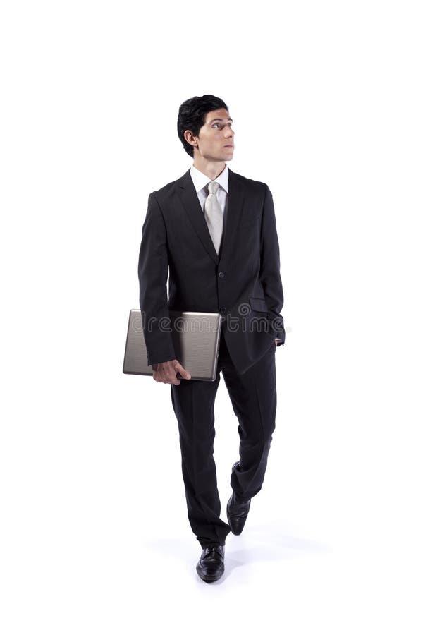 En zakenman die naar boven gaat kijkt stock foto
