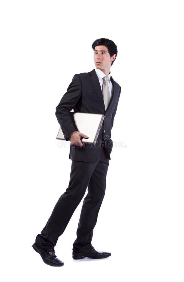 En zakenman die terug loopt kijkt stock afbeeldingen