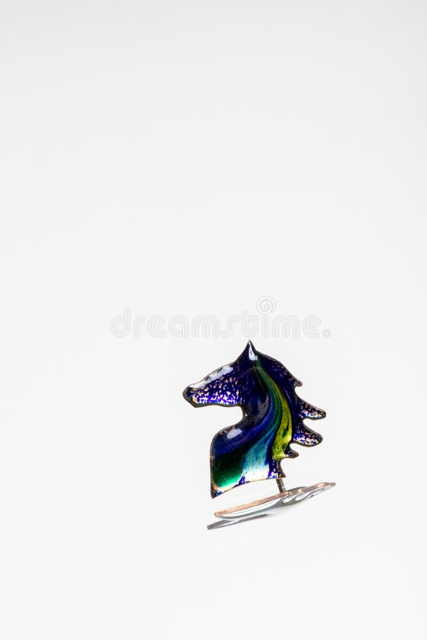 Enamel horse head on a light background stock photos