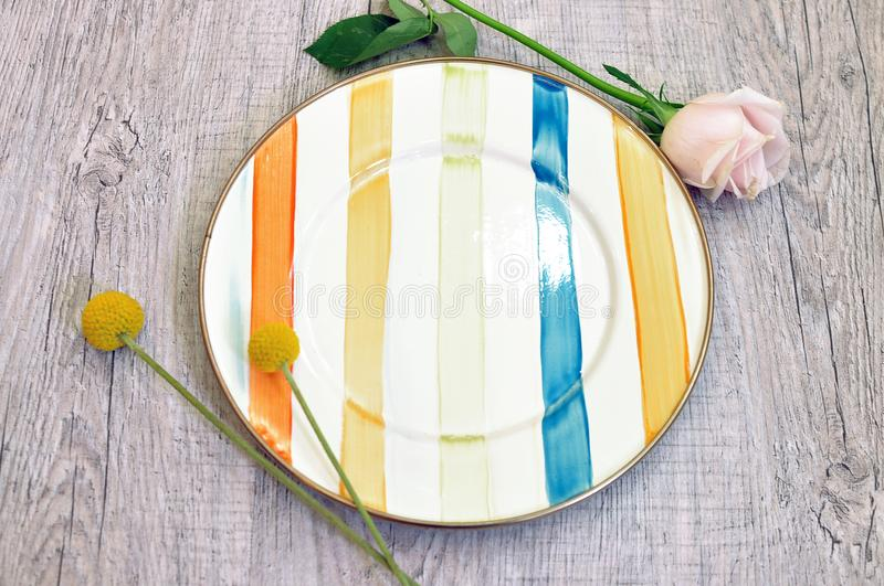 Enamel plate on a wooden background. plate top view. royalty free stock photo