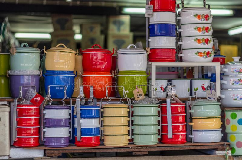 Enamel porcelain dishes and pots multicolor old style royalty free stock images