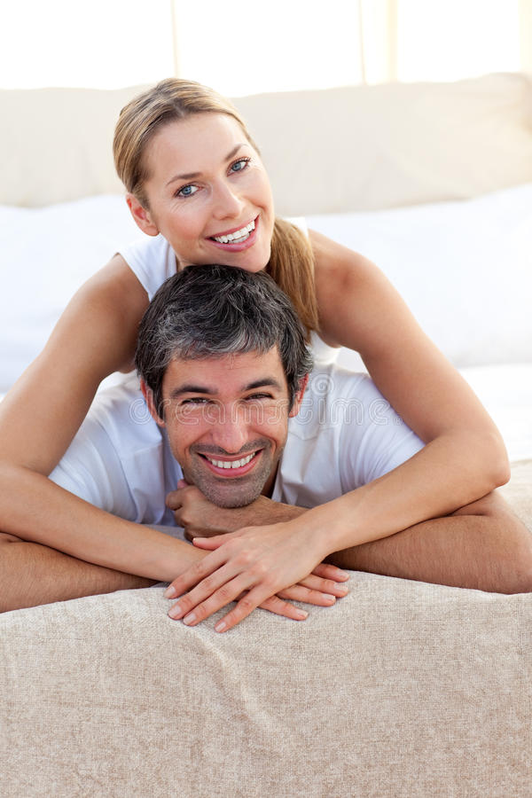Enamored couple lying on the bed
