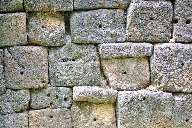 Enarene la piedra en la pieza de la pared, prasat muangsing el parque histórico en Kanchanaburi, Tailandia foto de archivo