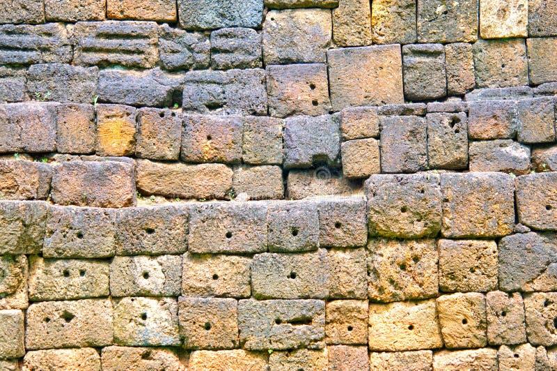 Enarene la piedra en la pieza de la pared, prasat muangsing el parque histórico en Kanchanaburi, Tailandia fotografía de archivo libre de regalías