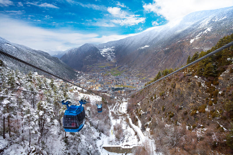 Encamp town in Andorra and cable car. For lifting skiers and snowboarders to the top of the mountain stock image