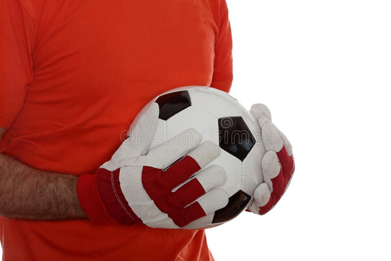 Encargado de la meta con el balón de fútbol fotografía de archivo