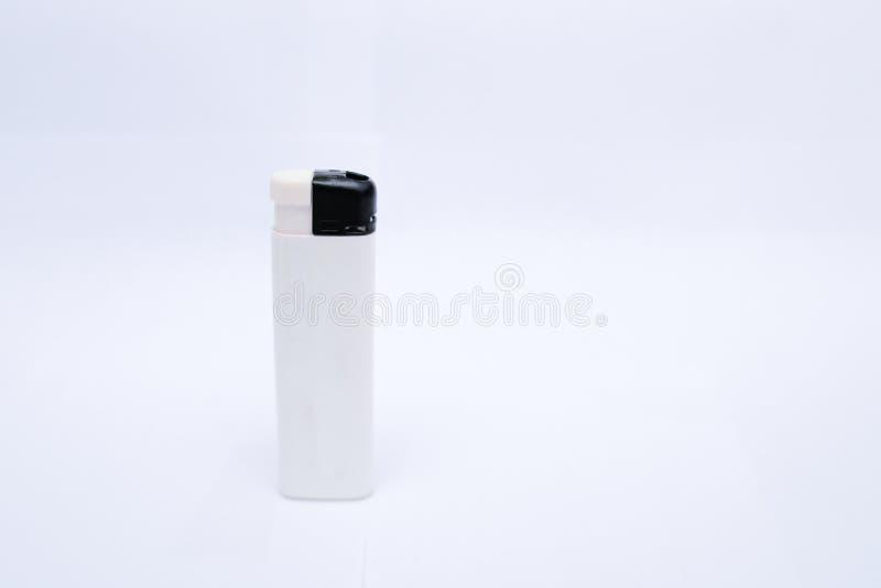 Encendedor blanco en un fondo blanco fotografía de archivo