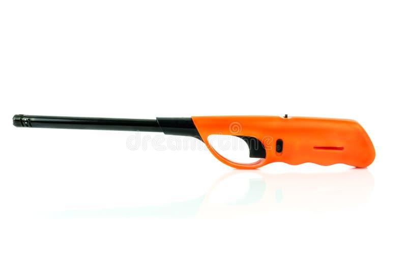 Encendedor de gas anaranjado con la empuñadura de pistola imagenes de archivo