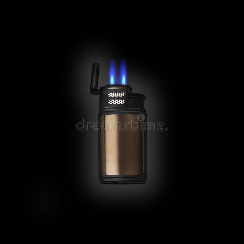 Encendedor electrónico con la llama de jet doble fotografía de archivo