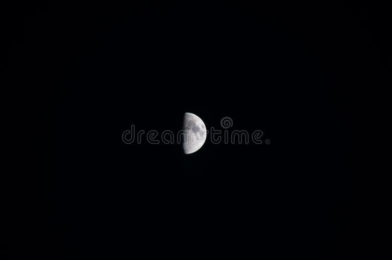 Encerar el primer trimestre de la luna fotografía de archivo libre de regalías