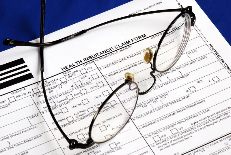 Encha o formulário de reivindicação do seguro de saúde foto de stock royalty free