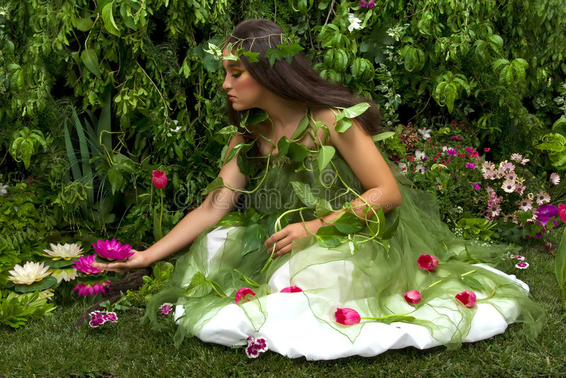 Enchanted Garden. Mother Nature looking upon some of her many beautiful creations in her enchanted garden. This indoor studio shoot is a compilation of many stock image