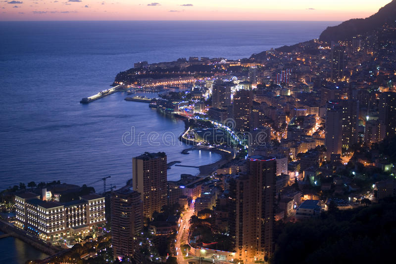 Enchanting Monegasque dusk. By dusk, Monaco dress with ephemeral colours, between the pink of the sunset and the blue of the sea royalty free stock photo