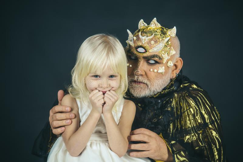 Enchantment on halloween. mystery enchantment of halloween monster and happy little girl. little girl smiling near magic royalty free stock photography