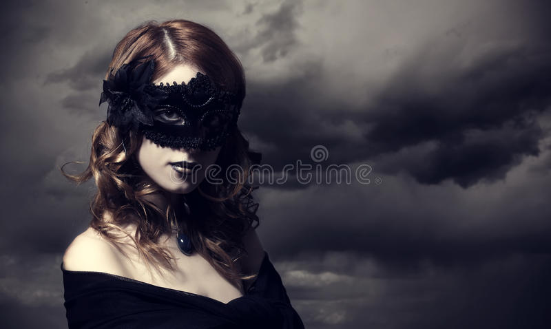 Enchantress at storm sky background. stock photography