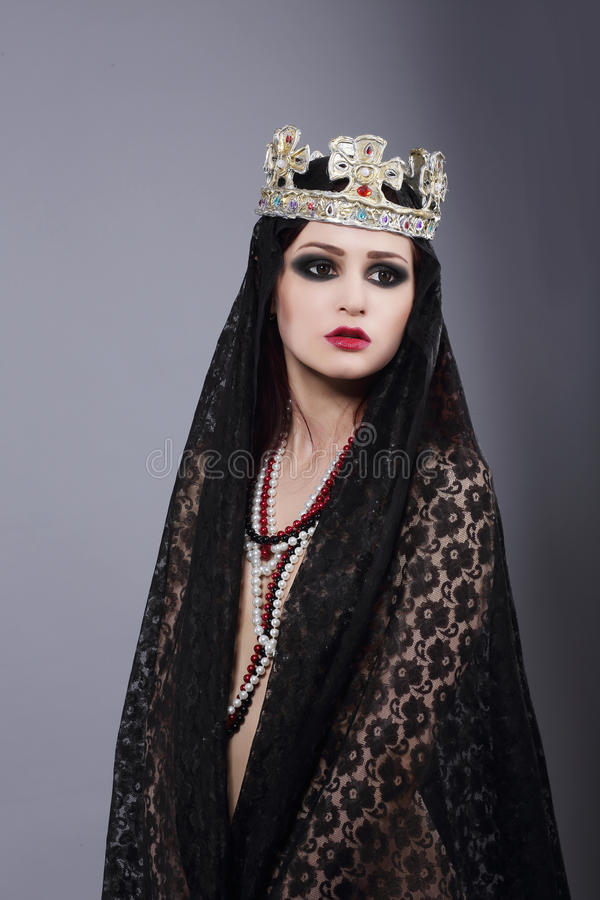 Enchantress.Wizard in Ancient Mantle and Crown. Wizard in Ancient Dark Mantle and Crown stock photo