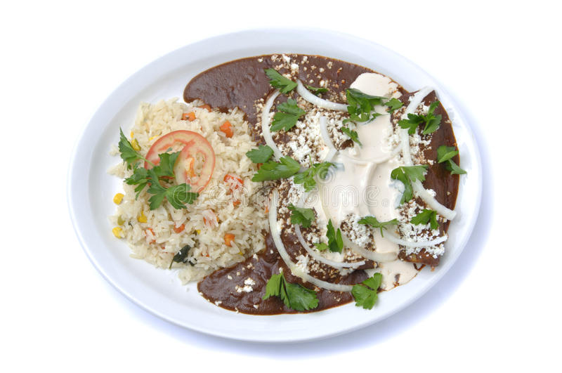 Enchiladas com toupeira, arroz e feijões imagens de stock royalty free