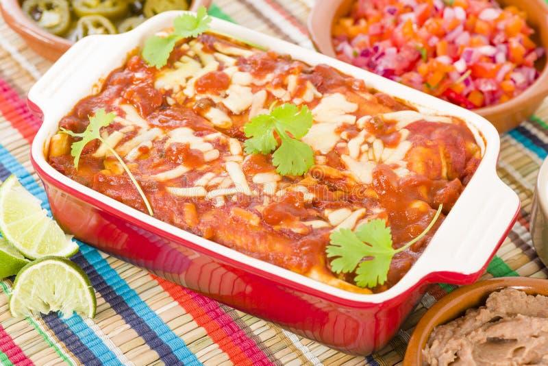 Enchiladas del pollo y del chorizo imagenes de archivo