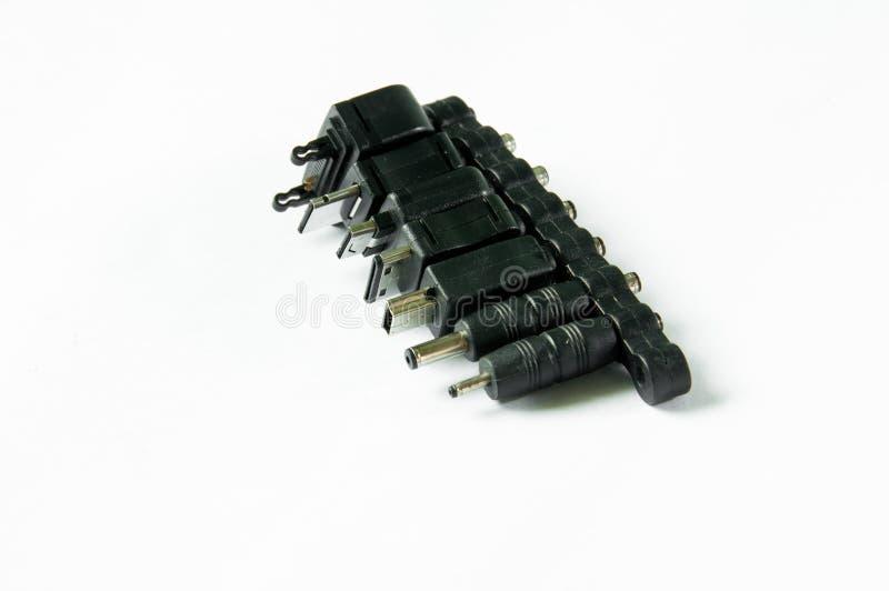 Enchufes de la carga por USB del teléfono móvil fotos de archivo