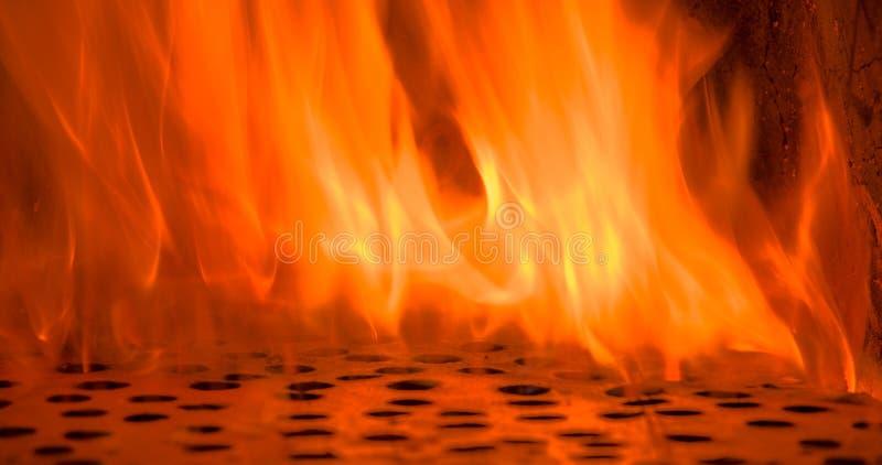 Encienda las llamas con el calabozo, fondo de la textura de la llama del fuego del resplandor imágenes de archivo libres de regalías