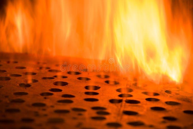 Encienda las llamas con el calabozo, fondo de la textura de la llama del fuego del resplandor fotografía de archivo