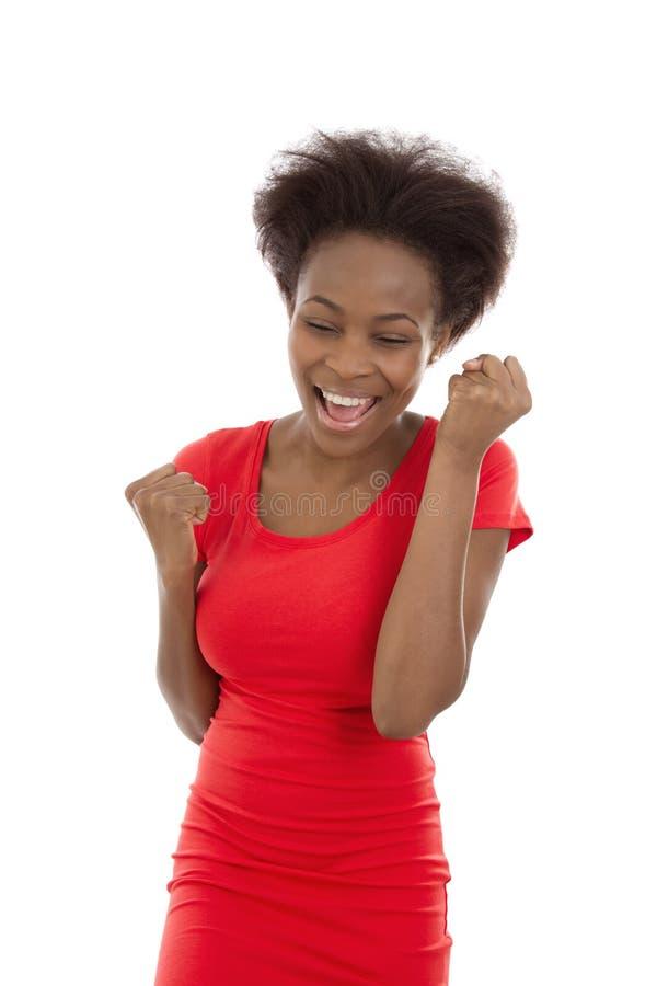 Encourager d'isolement et jeune femme de couleur afro-américaine réussie image stock