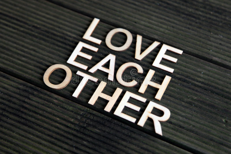 Encouraging words. That says to love each other stock photo