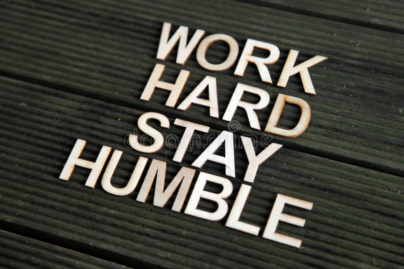 Encouraging words. That says to work hard and stay humble stock photo