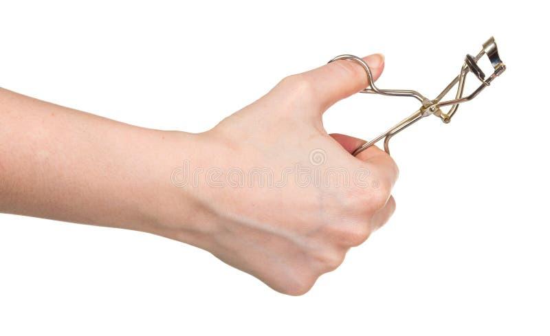 Encrespador de ondulação da pestana da mão fêmea isolado no branco fotografia de stock royalty free