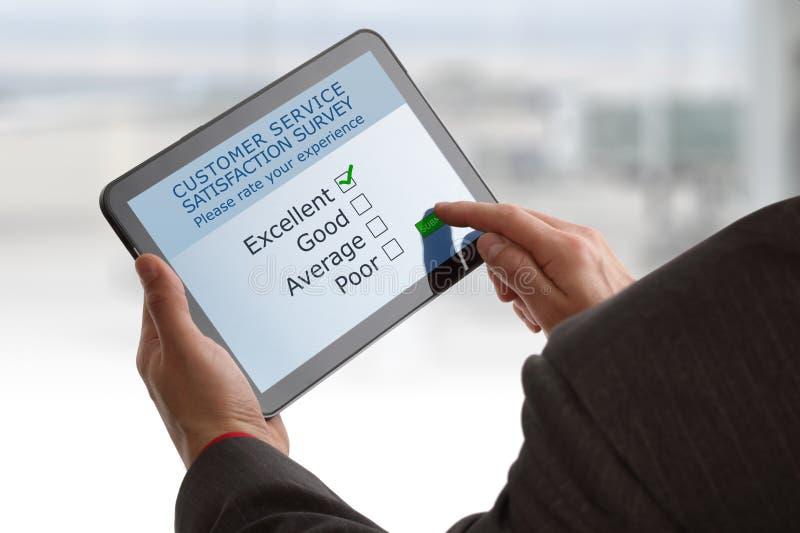 Encuesta sobre en línea la satisfacción del servicio de atención al cliente foto de archivo