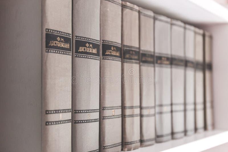 Encyclopedias on shelf stock images