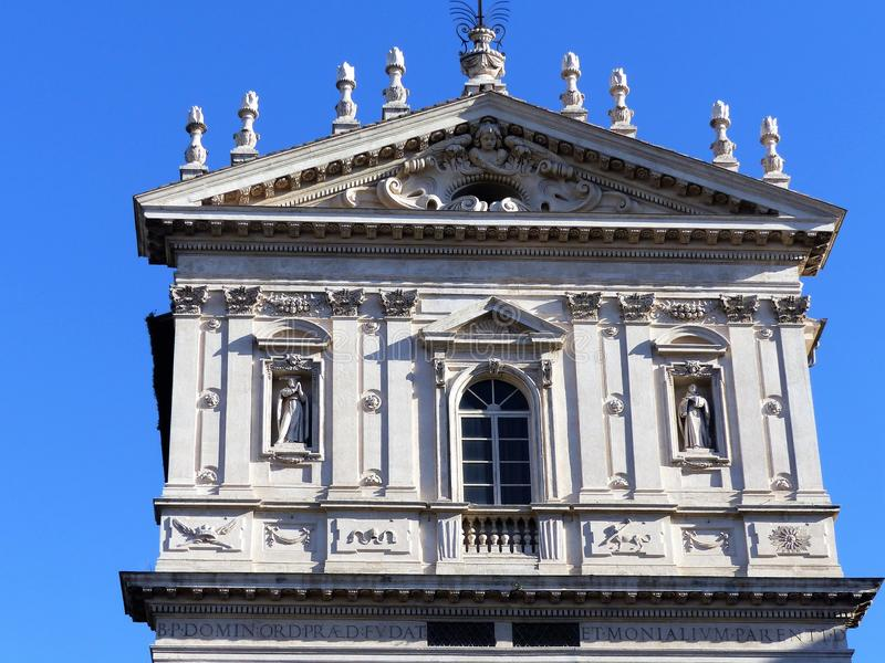 End of the baroque facade of the church of Saints Dominic and Sisto to Rome in Italy. stock photography
