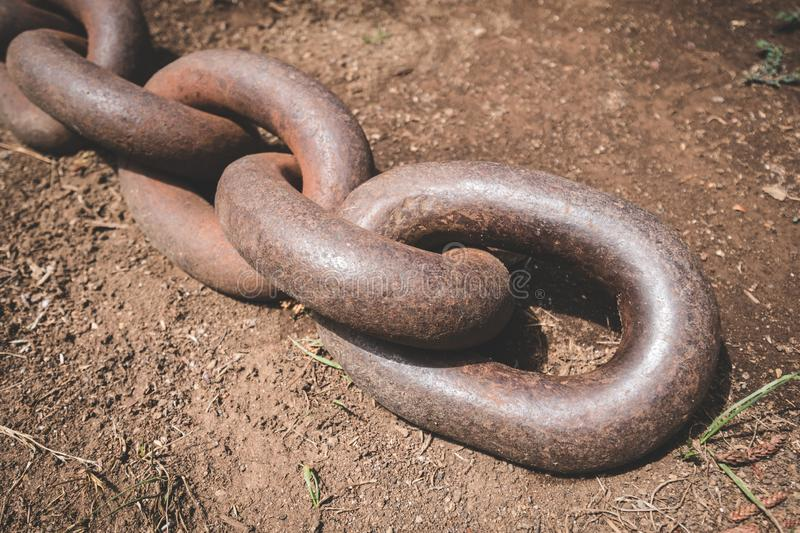 End of big rusty anchor chain on floor closeup.  royalty free stock photography