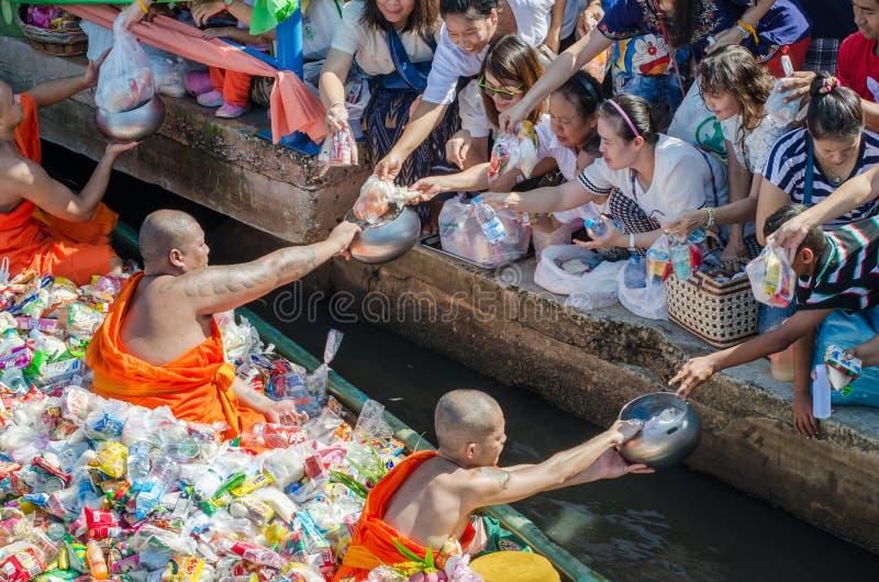 End of Buddhist Lent. BANGKOK,THAILAND-November 1,2015 : Thai people offerings to a Buddhist monks on Ok Phansa day(End of Buddhist Lent) in Ladkrabang, Bangkok stock photo