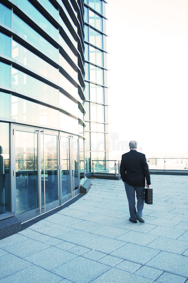 End of a business day. Business man leaving after a working day royalty free stock image